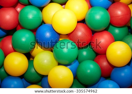 Group of many multicolored plastic balls. Close-up view - stock photo