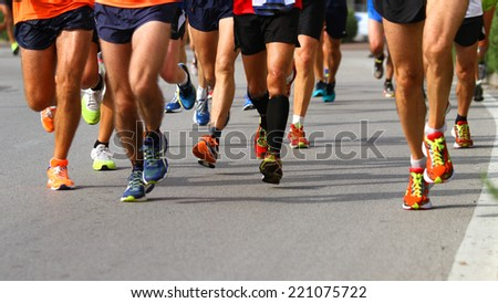 Group of marchers during the sporting competition on the street - stock photo