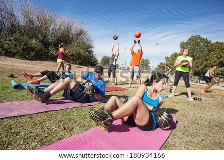 Group of mature adults working out in fitness class - stock photo