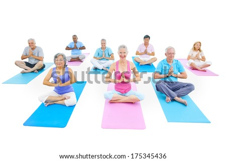 Group of Mature People Doing Yoga - stock photo