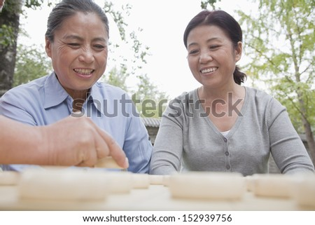 Group of mature women playing Chinese checkers
