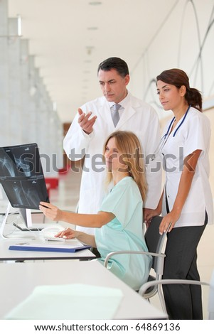 Group of medical people looking at xray