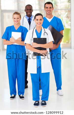 group of medical workers full length portrait in hospital - stock photo