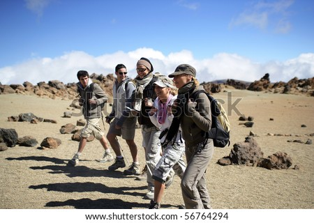 Group of men and women hiking - stock photo