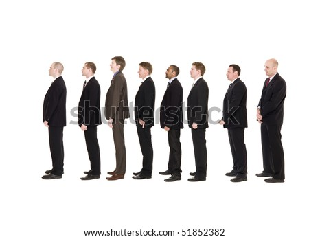 Group of men standing in a line waiting - stock photo