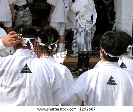 Group of men wearing traditional clothes during Gion Matsuri the biggest Japanese festival.