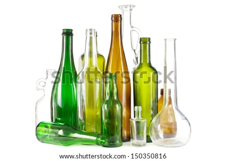 Group of mixed colored glass waste bottles on white - stock photo