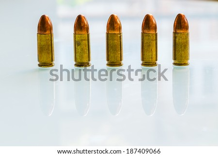 Group of 9mm bullets on white background white reflect - stock photo
