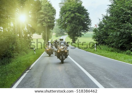 Group of motorcycle on highway with sunlight flare