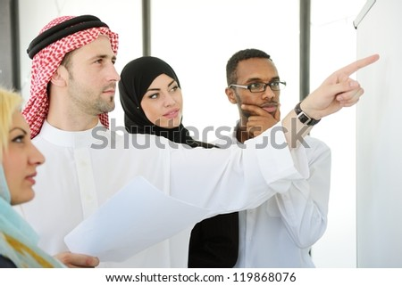 Group of multi ethnic business people at work - stock photo