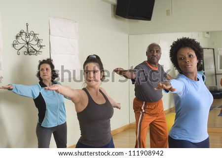 Group of multi ethnic people practicing yoga - stock photo