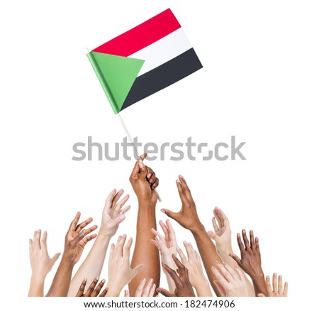 Group Of Multi-Ethnic People Reaching For And Holding The Flag Of Sudan - stock photo