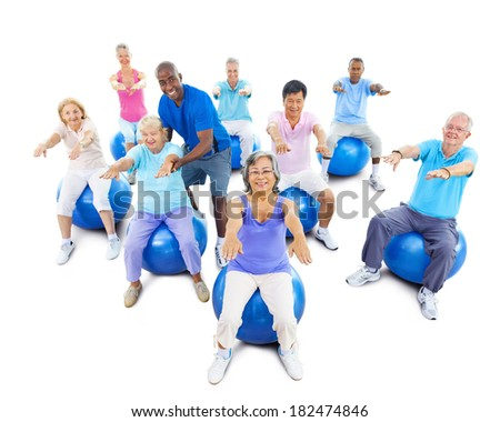 Group Of Multi-Ethnic Senior Adults Exercising With Instructor