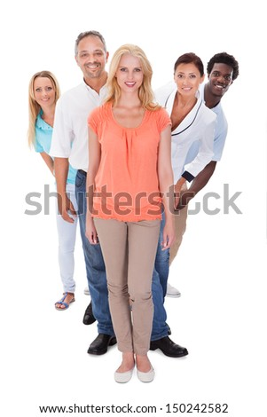 Group Of Multi-racial People Standing In A Row On White Background
