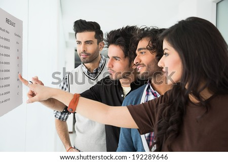 group of multi racial students checking the results - stock photo
