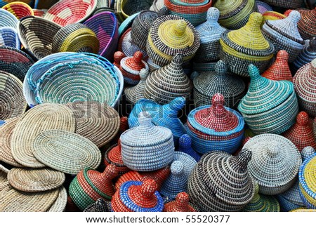 Group of multicolored woven baskets (selective focus the ones at the bottom of the image)
