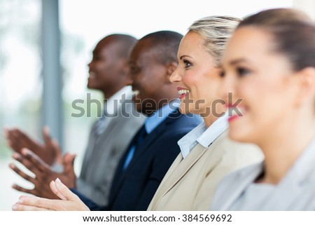 group of multicultural business people applauding - stock photo