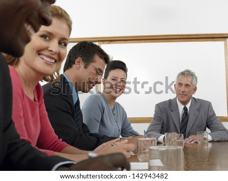Group of multiethnic business people discussing in conference room - stock photo