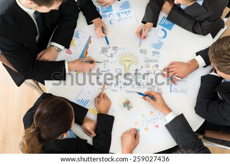 Group Of Multiethnic Businesspeople Planning For Startup In Meeting - stock photo