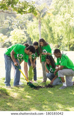Group of multiethnic environmentalists gardening in park - stock photo