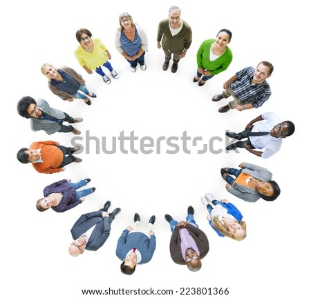 Group of Multiethnic People in a Circle Looking Up - stock photo