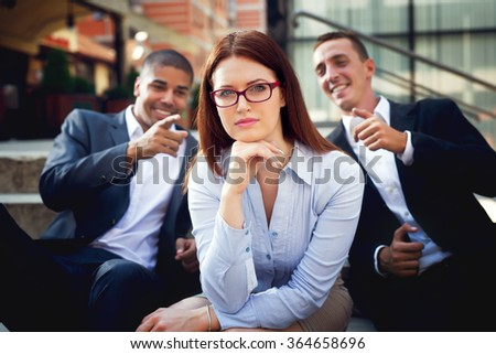 Group of multiracial business people. Gossip girl. - stock photo