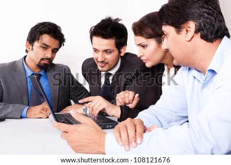group of multiracial business people in meeting - stock photo