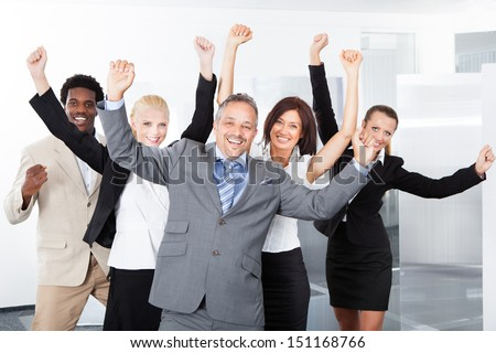 Group Of Multiracial Businesspeople Enjoying Their Success - stock photo