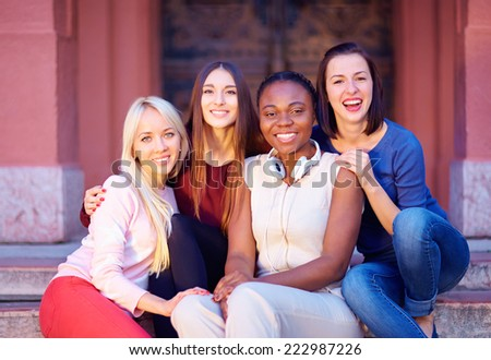 group of multiracial female friends outdoors - stock photo