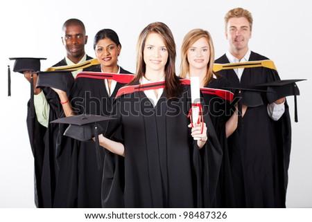 group of multiracial graduates at graduation holding caps - stock photo