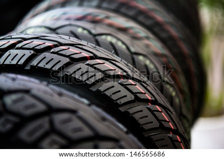 Group of  new tires for sale at a tire store. selective focus. - stock photo