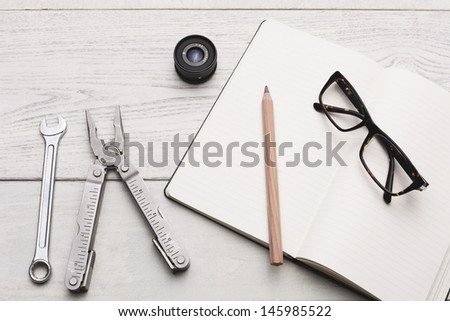 Group of objects and a plain textbook on white hardwood table, Studio shot.  - stock photo
