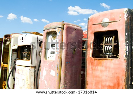 Group of Obsolete, Vintage Gas Pumps - stock photo