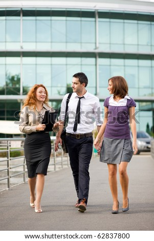 Group of office workers walk outdoor - stock photo