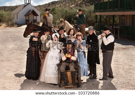 Group of old American west townspeople with weapons - stock photo