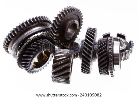 Group of old and rusty transmission gears isolated on a white background