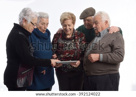 group of older person with a digital tablet - stock photo
