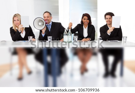 Group of panel judges holding empty score signs - stock photo