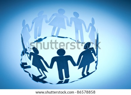 Group of paper doll people holding hands. Social network concept - stock photo