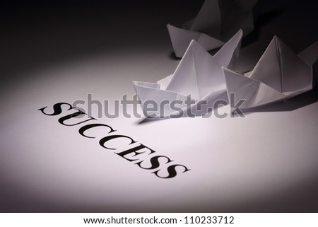 Group of paper origami ships - stock photo