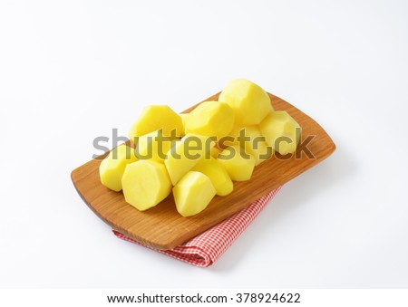 Group of peeled potatoes ready to cook - stock photo