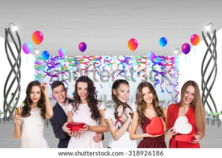 Group of people are celebrating with champagne in a cafe - stock photo