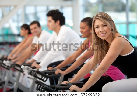 Group of people at the gym and smiling - stock photo