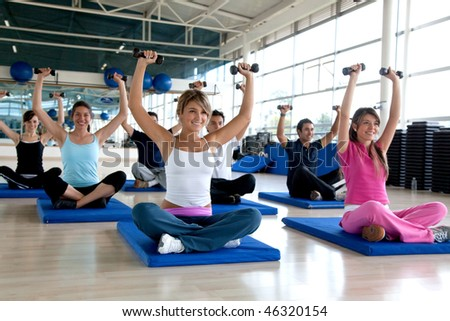 Group of people at the gym in a class