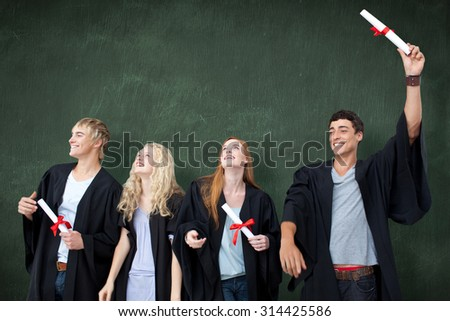 Group of people celebrating after Graduation against green chalkboard - stock photo