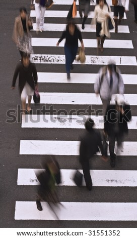 Group of people crossing the street-upper view