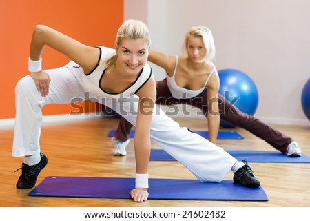 Group of people doing stretching exercise - stock photo