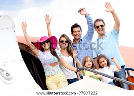 Group of people going on a family trip by airplane - stock photo
