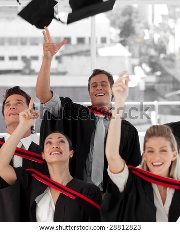 Group of people Graduating from College from different cultures - stock photo