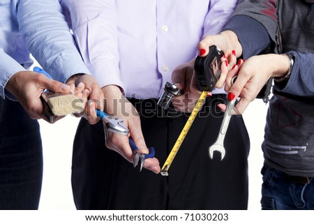 Group of people hands with lots of house improvement tools (selective focus) - stock photo